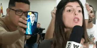 Vídeo: Homem 'invade' transmissão ao vivo da Globo e mostra foto do presidente Bolsonaro