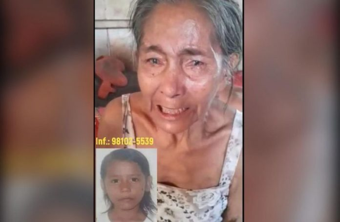 Avó chora com a foto da Edilene Cordeiro da Silva, de 9 anos