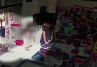 Vídeo mostra o momento em que uma menina entrou desesperada em um supermercado fugindo do ataque de um Pitbull